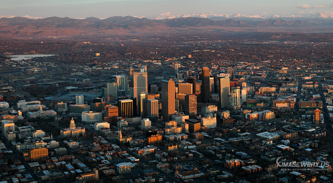 A great morning to watch the sunrise on Denver Colorado from the airplane.